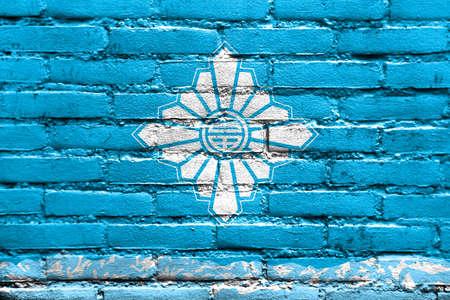 far east: Flag of Toyama, Japan, painted on brick wall