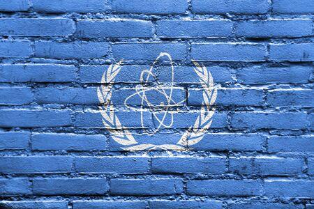 atomic energy: Flag of the International Atomic Energy Agency (IAEA), painted on brick wall