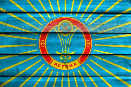 wood plank: Flag of Astana, painted on old wood plank background Stock Photo