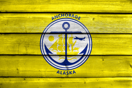 anchorage: Flag of Anchorage, Alaska, painted on old wood plank background Stock Photo