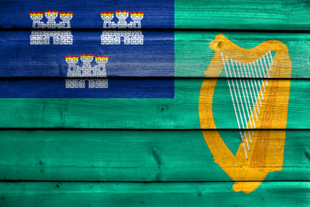 education policy: Flag of Dublin, painted on old wood plank background