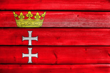 painted wood: Flag of Gdansk, Poland, painted on old wood plank background