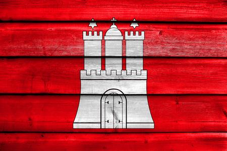hamburg: Flag of Free and Hanseatic City of Hamburg, painted on old wood plank background