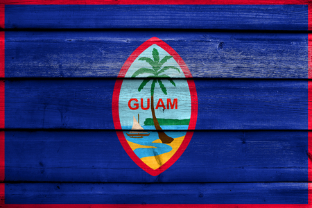 unincorporated: Flag of Guam, painted on old wood plank background