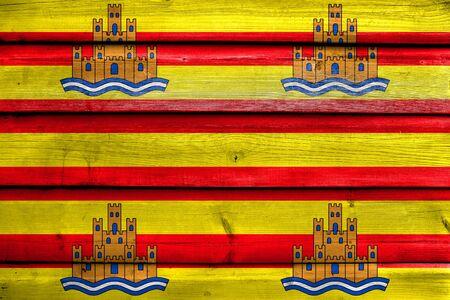 ibiza: Flag of Ibiza, painted on old wood plank background