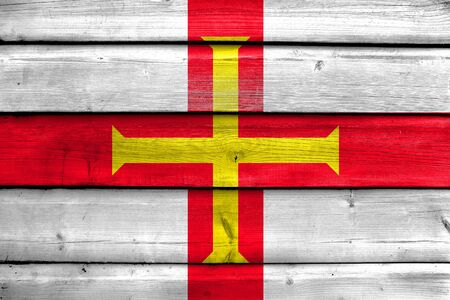 guernsey: Flag of Guernsey, painted on old wood plank background