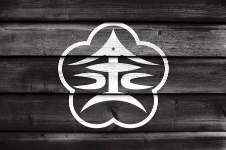 far east: Flag of Kanazawa, Japan, painted on old wood plank background Stock Photo