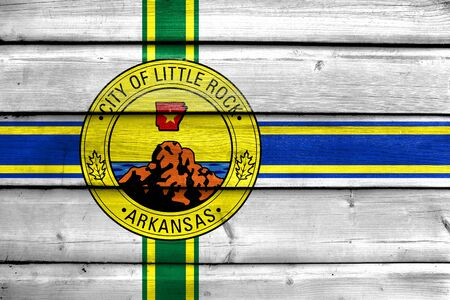 little rock: Flag of Little Rock, Arkansas, painted on old wood plank background Stock Photo
