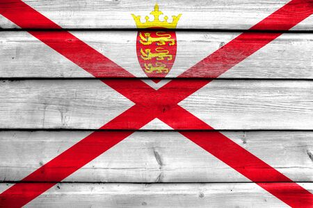 painted wood: Flag of Jersey, painted on old wood plank background