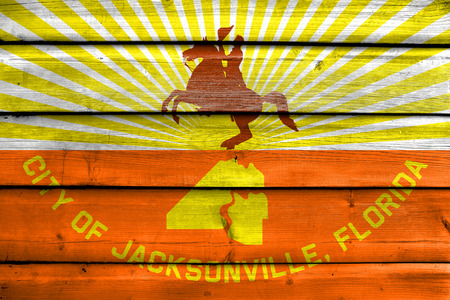jacksonville: Flag of Jacksonville, Florida, painted on old wood plank background