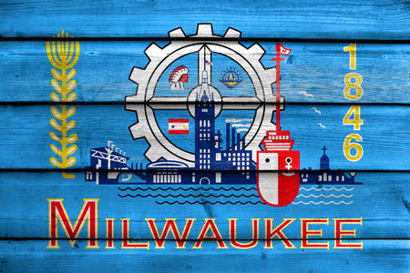 milwaukee: Flag of Milwaukee, Wisconsin, painted on old wood plank background