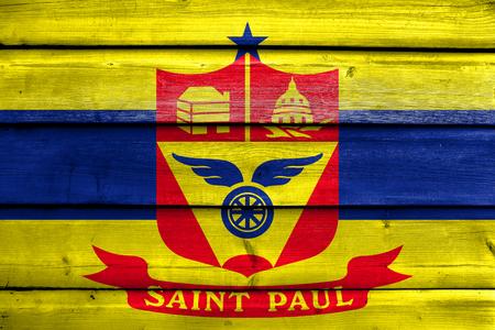 saint paul: Flag of Saint Paul, Minnesota, painted on old wood plank background Stock Photo
