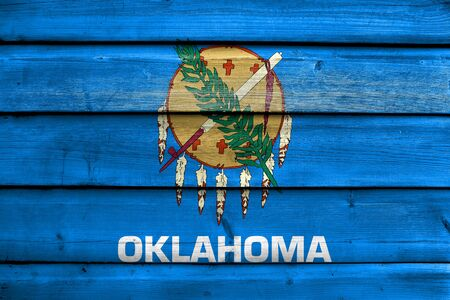 old flag: Flag of Oklahoma State, painted on old wood plank background