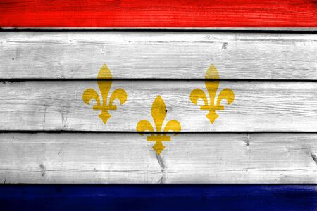 orleans symbol: Flag of New Orleans, Louisiana, painted on old wood plank background