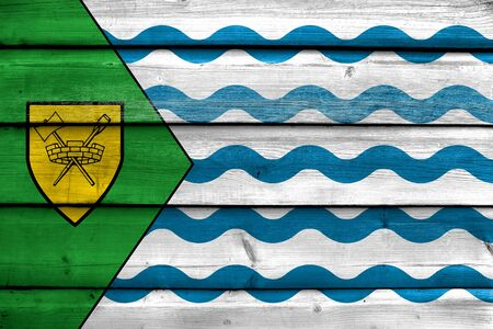 painted wood: Flag of Vancouver, painted on old wood plank background
