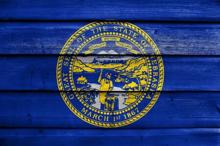 painted wood: Flag of Nebraska State, painted on old wood plank background