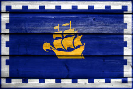 painted wood: Flag of Quebec City, painted on old wood plank background