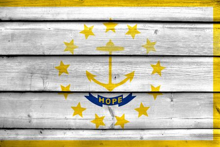 new england: Flag of Rhode Island, painted on old wood plank background Stock Photo