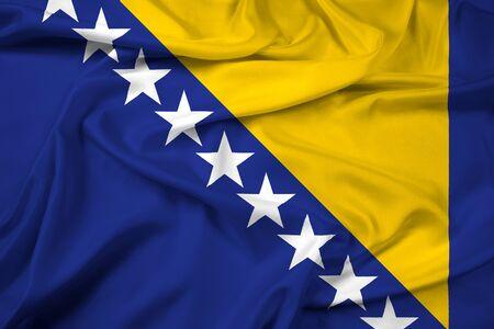 bosnian: Waving Flag of Bosnia and Herzegovina Stock Photo