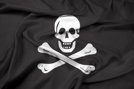 piracy: Waving The traditional Jolly Roger of piracy Flag Stock Photo