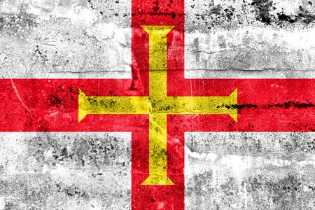 education policy: Flag of Guernsey, painted on dirty wall. Vintage and old look. Stock Photo