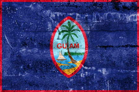 unincorporated: Flag of Guam, painted on dirty wall. Vintage and old look.