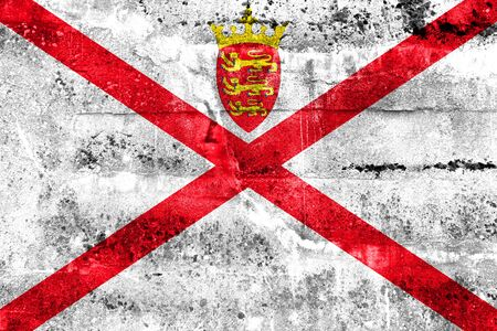 bailiwick: Flag of Jersey, painted on dirty wall. Vintage and old look. Stock Photo