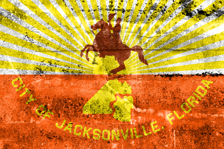 jacksonville: Flag of Jacksonville, Florida, painted on dirty wall. Vintage and old look.