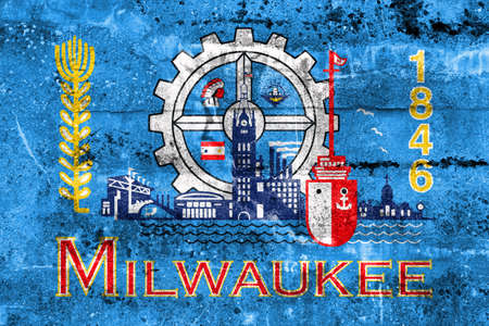 education policy: Flag of Milwaukee, Wisconsin, painted on dirty wall. Vintage and old look.