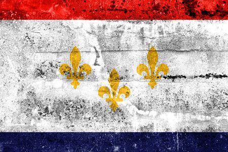 new look: Flag of New Orleans, Louisiana, painted on dirty wall. Vintage and old look.