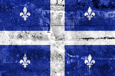 Flag of Quebec, painted on dirty wall. Vintage and old look. Фото со стока
