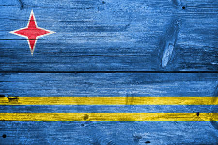 carribean: Flag of Aruba, painted on old wood plank background