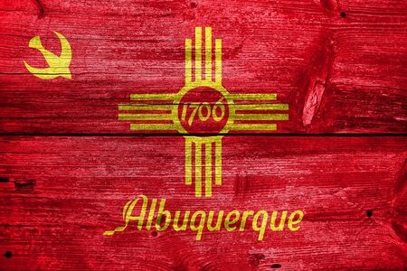 albuquerque: Flag of Albuquerque, New Mexico, painted on old wood plank background