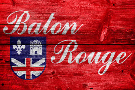 baton rouge: Flag of Baton Rouge, Louisiana, painted on old wood plank background