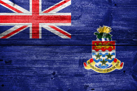 cayman islands: Flag of Cayman Islands, painted on old wood plank background