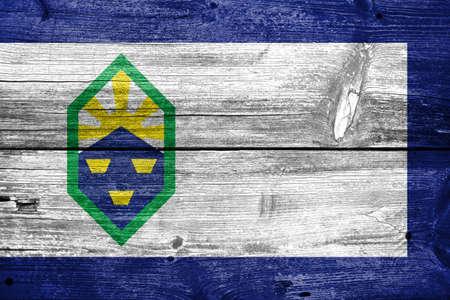 colorado springs: Flag of Colorado Springs, Colorado, painted on old wood plank background