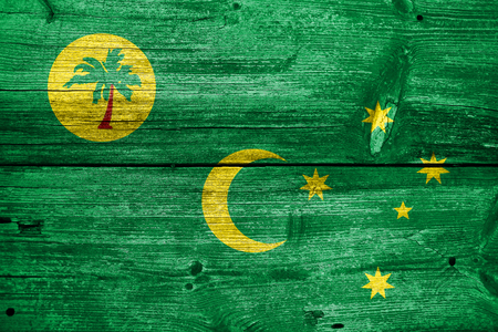 Flag of Cocos Islands, painted on old wood plank background