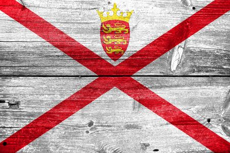 bailiwick: Flag of Jersey, painted on old wood plank background