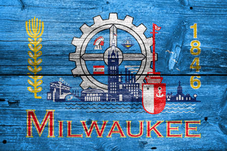 milwaukee: Flag of Milwaukee, Wisconsin, painted on old wood plank background
