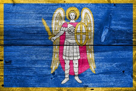 painted wood: Flag of Kiev, painted on old wood plank background Stock Photo