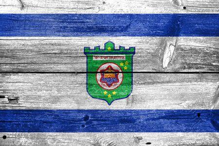 aviv: Flag of Tel Aviv, painted on old wood plank background Stock Photo