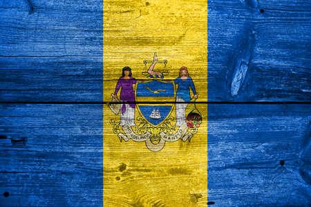 philadelphia: Flag of Philadelphia, Pennsylvania, painted on old wood plank background Stock Photo