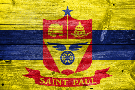 paul: Flag of Saint Paul, Minnesota, painted on old wood plank background Stock Photo