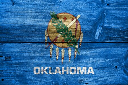 education policy: Flag of Oklahoma State, painted on old wood plank background