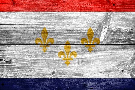 new orleans: Flag of New Orleans, Louisiana, painted on old wood plank background