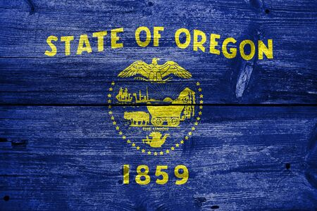 state of oregon: Flag of Oregon State, painted on old wood plank background