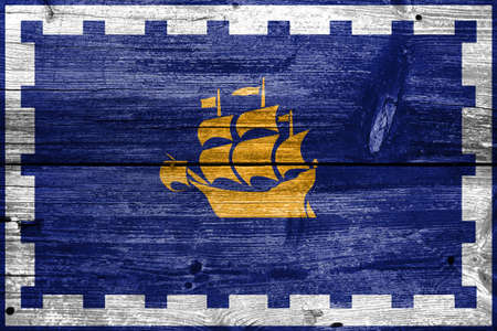 quebec city: Flag of Quebec City, painted on old wood plank background