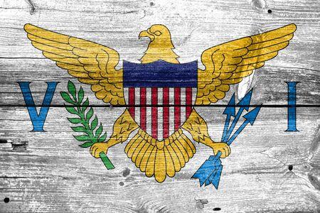virgin islands: Flag of the U.S. Virgin Islands, painted on old wood plank background