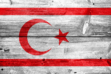 painted wood: Flag of Northern Cyprus, painted on old wood plank background Stock Photo