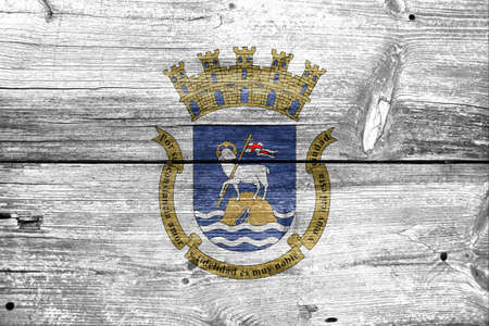 unincorporated: Flag of San Juan, Puerto Rico, painted on old wood plank background